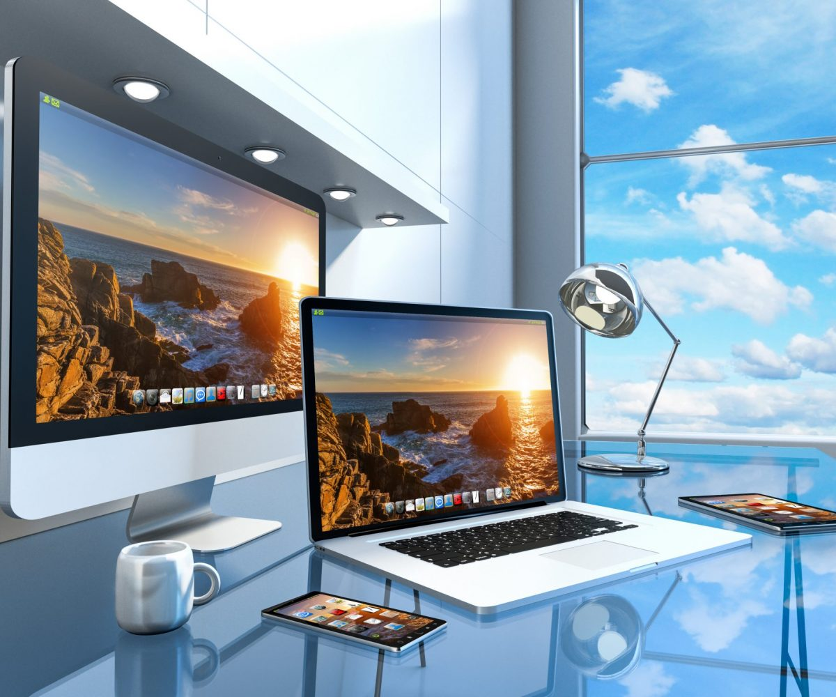 Modern blue glass desk office interior with computer and digital devices 3D rendering
