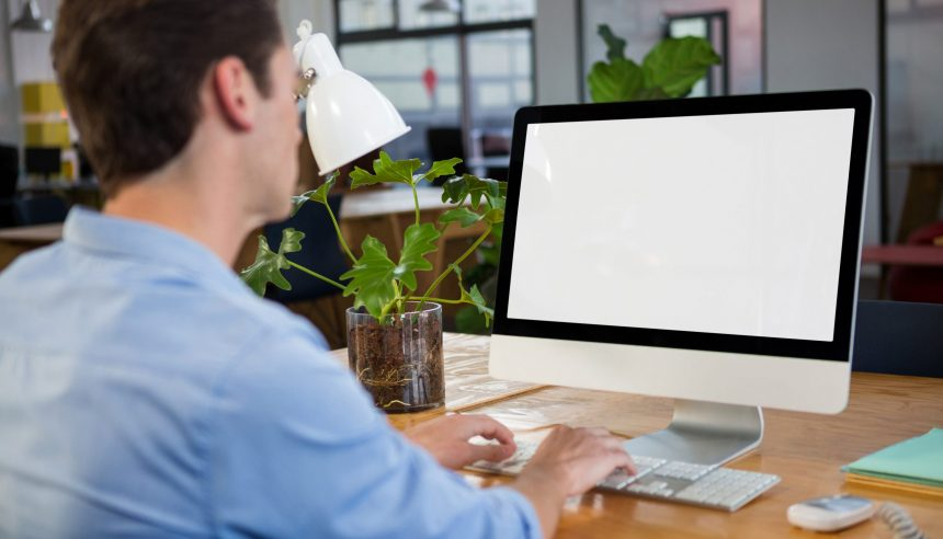 Graphic designer working on computer in creative office